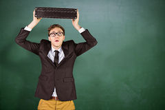 Composite image of young geeky businessman holding briefcase Stock Image