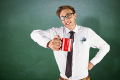 Composite image of young geeky businessman holding mug Stock Images