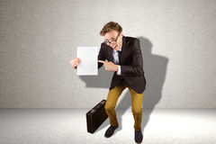 Composite image of young geeky businessman holding page Stock Image