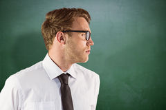 Composite image of young geeky businessman looking away Royalty Free Stock Photography