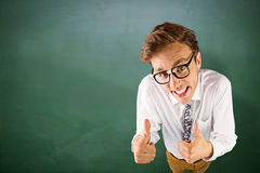 Composite image of young geeky businessman showing thumbs up Royalty Free Stock Photography