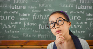 Composite image of young girl looking up. Young girl looking up against blackboard Stock Image