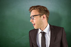 Composite image of young handsome businessman looking away Stock Image
