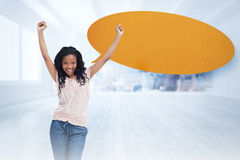 Composite image of a young happy woman with speech bubble Stock Image
