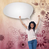 Composite image of a young happy woman with speech bubble Royalty Free Stock Images