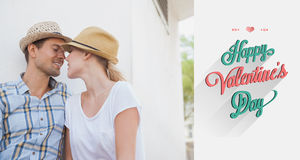 Composite image of young hip couple sitting on bench about to kiss. Young hip couple sitting on bench about to kiss against valentines day greeting stock image