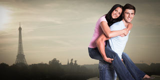 Composite image of young man giving girlfriend a piggyback ride Royalty Free Stock Photography