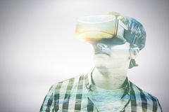 Composite image of young man wearing virtual reality glasses. Young man wearing virtual reality glasses against serene beach landscape Stock Photos