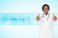 Composite image of young nurse giving thumbs up Stock Photo
