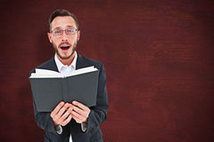 Composite image of young preacher reading from bible Royalty Free Stock Photos