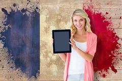 Composite image of young pretty student showing tablet pc Stock Images