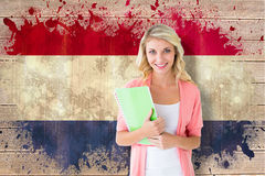 Composite image of young pretty student smiling Stock Photo