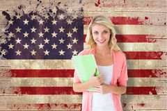 Composite image of young pretty student smiling Royalty Free Stock Image