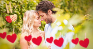 Composite image of young romantic couple embracing each other Royalty Free Stock Images