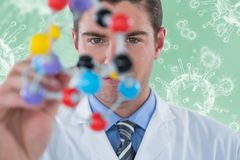 Composite image of young scientist experimenting molecule structure 3d. Young scientist experimenting molecule structure against digitally composite image of royalty free stock photo