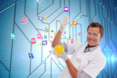 Composite image of young scientist working with a beaker Stock Photography