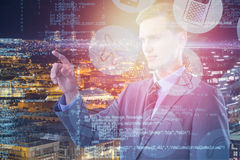Composite image of young smart businessman pointing 3d. Young smart businessman pointing against high angle view of illuminated crowded cityscape 3d Royalty Free Stock Image