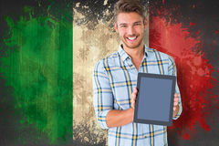 Composite image of young student showing tablet pc Royalty Free Stock Photos