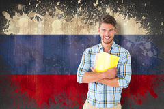 Composite image of young student smiling Royalty Free Stock Photography