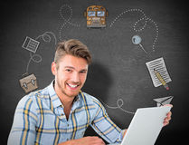 Composite image of young student using laptop Royalty Free Stock Photo