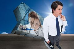 Composite image of young tradesman with his jacket and suitcase Royalty Free Stock Photos