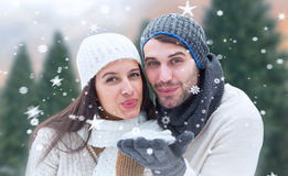 Composite image of young winter couple Stock Photos