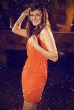 Composite image of young woman dancing on dance floor Stock Photography