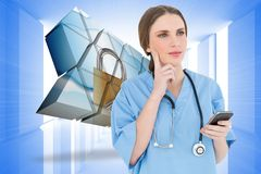 Composite image of young woman doctor thinking Stock Image