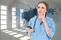 Composite image of young woman doctor thinking Stock Photography