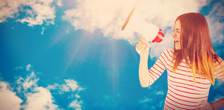 Composite image of young woman yelling with megaphone Royalty Free Stock Image