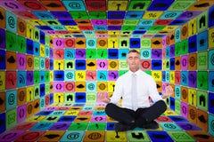 Composite image of zen businessman meditating in lotus pose Stock Photos