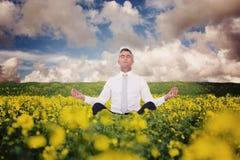 Composite image of zen businessman meditating in lotus pose Stock Images