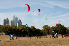 Composite Of Multiple Kites Flying Set Against City Skyline Stock Photo