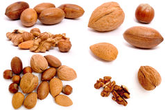 Composite nuts. Full-size composite photo of various isolated nuts with realistic drop shadows for depth on white background. Contains hazel, almond, walnut and Stock Image