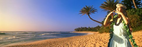 Composite panoramic image of Hawaiian native dancer and coastline in Hawaii Stock Photo