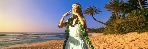 Composite panoramic image of Hawaiian native dancer and coastline in Hawaii Stock Photos