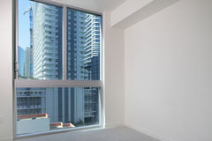 Composite photo of a room with a view of a city Stock Photos