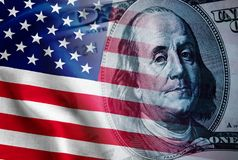 Composite of the US flag and 100 dollar bill. With the portrait of Benjamin Franklin in a concept of United States finances, currency, and economy stock photos