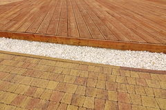 Composite Wood Decking, White Marble Gravel And Stone Brick Pavi Royalty Free Stock Photo