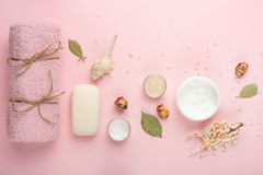 Composition and accessories spa, towel, cream, soap, bath salt rose petals royalty free stock photo