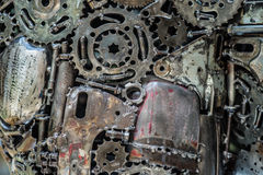 Composition of aged metal parts. (gear wheels, iron chain) coloured patina. Macro view, closeup Stock Photography