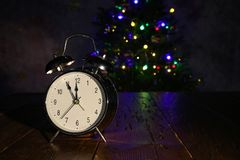Composition with alarm Glock and Christmas tree. Composition with an alarm clock and a Christmas tree royalty free stock photos