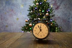Composition with alarm Glock and Christmas tree. Composition with an alarm clock and a Christmas tree royalty free stock photo