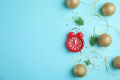 Composition with alarm clock and decorations on color background. Christmas countdown Stock Photos