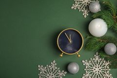 Composition with alarm clock and decorations on color background. Christmas countdown Stock Image