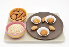 Composition with almond cookies and oatmeal Stock Photos