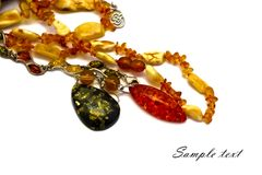 Composition of amber jewelry Stock Photo