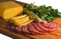 Composition of appetizing sausage, cheese, greens and onions on a wooden board, isolate royalty free stock images