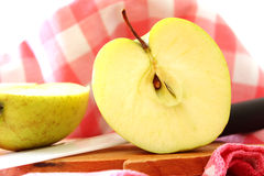 Apple cut in half Royalty Free Stock Image