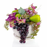 Composition from artificial flowers and fruits. Stock Photos